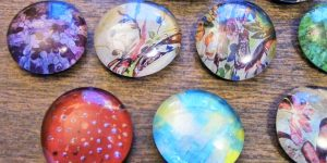 She Puts Photos On Flat Marbles…Watch How She Does It And The Cool Items She Makes!