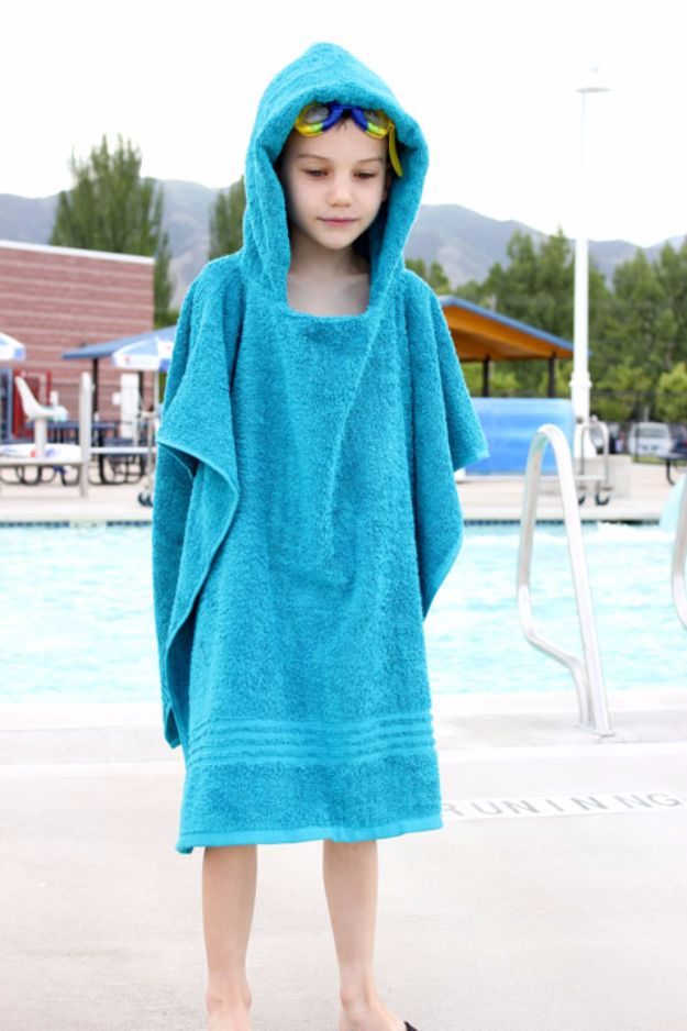 DIY Ideas With Old Towels - Hooded Towel Poncho - Cool Crafts To Make With An Old Towel - Cheap Do It Yourself Gifts and Home Decor on A Budget - Creative But Cheap Ideas for Decorating Your House and Room - Upcycle Those Towels Instead of Throwing Them Away! http://diyjoy.com/diy-ideas-old-towels