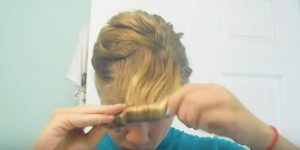 Make A 50s Statement For Halloween And Start By Doing A Tight Roll In Front Of Your Hair