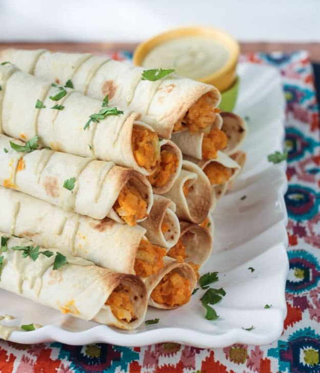 New Years Eve Party Recipes -Baked Buffalo Chickpea And Artichoke Vegan Taquitos - Best New Year Drinks, Cocktails, Appetizers and Party Foods for Your New Year's Eve Celebration - Quick Desserts, Snacks, Dips, Finger Foods, Cake and Champagne Toast Recipe Ideas - Fun and Easy Foods To Serve For A Crowd #newyears #recipes