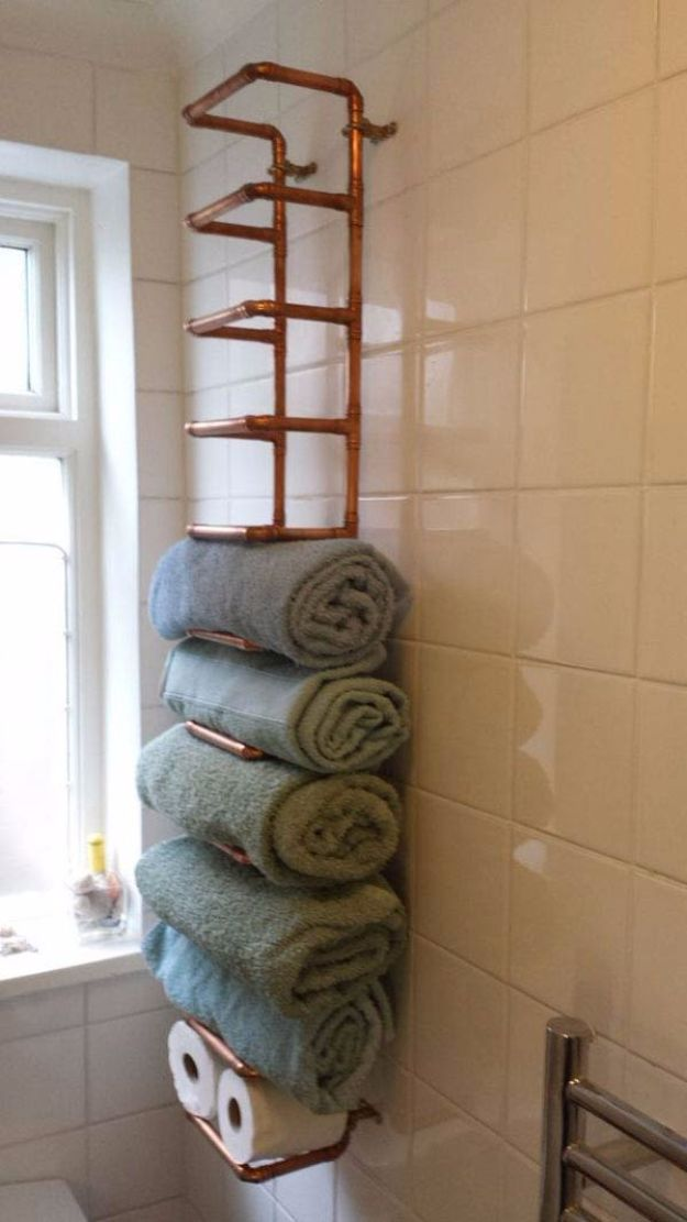 DIY Bathroom Storage Ideas - Copper Pipe Towel Rail - Best Solutions for Under Sink Organization, Countertop Jars and Boxes, Counter Caddy With Mason Jars, Over Toilet Ideas and Shelves, Easy Tips and Tricks for Small Spaces To Organize Bath Products http://diyjoy.com/diy-bathroom-storage-ideas