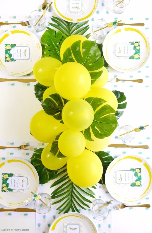 Balloon Crafts - DIY Balloon & Fronds Tropical Centerpiece - Fun Balloon Craft Ideas, Wall Art Projects and Cute Ballon Decor - DIY Balloon Ideas for Toddlers, Preschool Kids, Teens and Adults - Cheap Crafts Made With Balloons - Pumpkins, Bowls, Marshmallow Shooters, Balls, Glow Stick, Hot Air, Stress Ball http://diyjoy.com/balloon-crafts