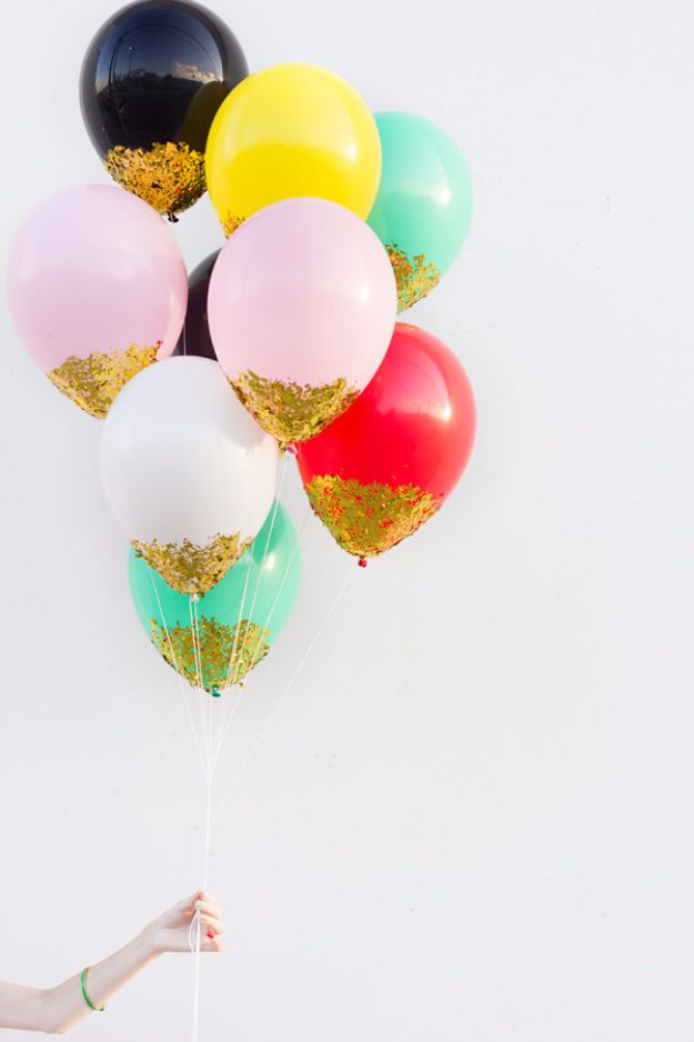 New Years Eve Decor Ideas - DIY Confetti Dipped Balloons - DIY New Year's Eve Decorations - Cheap Ideas for Banners, Balloons, Party Tables, Centerpieces and Festive Streamers and Lights - Cool Placecards, Photo Backdrops, Party Hats, Party Horns and Champagne Glasses - Cute Invitations, Games and Free Printables #diy #newyearseve #parties