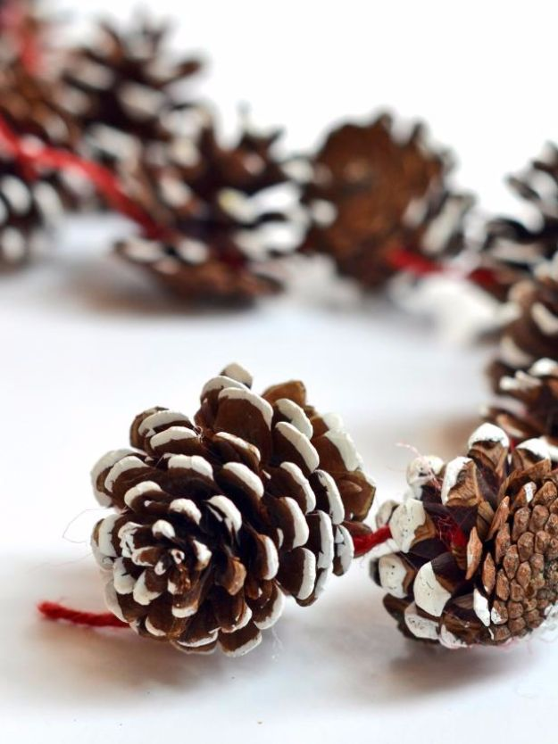 Cheap DIY Christmas Decor Ideas and Holiday Decorating On A Budget - DIY Holiday Pinecone Garland - Easy and Quick Decorating Ideas for The Holidays - Cool Dollar Store Crafts for Xmas Decorating On A Budget - wreaths, ornaments, bows, mantel decor, front door, tree and table centerpieces #christmas #diy #crafts