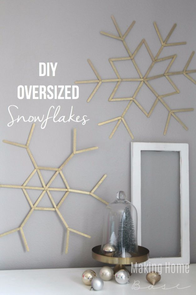 Cheap DIY Christmas Decor Ideas and Holiday Decorating On A Budget - DIY Oversized Snowflakes - Easy and Quick Decorating Ideas for The Holidays - Cool Dollar Store Crafts for Xmas Decorating On A Budget - wreaths, ornaments, bows, mantel decor, front door, tree and table centerpieces - best ideas for beautiful home decor during the holidays http://diyjoy.com/cheap-diy-christmas-decor