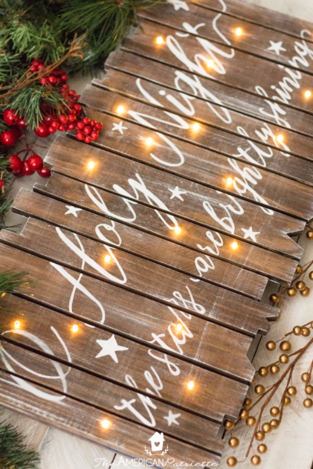 Cheap DIY Christmas Decor Ideas and Holiday Decorating On A Budget - DIY Rustic Light-Up Christmas Sign - Easy and Quick Decorating Ideas for The Holidays - Cool Dollar Store Crafts for Xmas Decorating On A Budget - wreaths, ornaments, bows, mantel decor, front door, tree and table centerpieces - best ideas for beautiful home decor during the holidays http://diyjoy.com/cheap-diy-christmas-decor