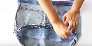 Watch How She Takes A Pair Of Old Jeans And Transforms Them Into A Fun And Useful Item!