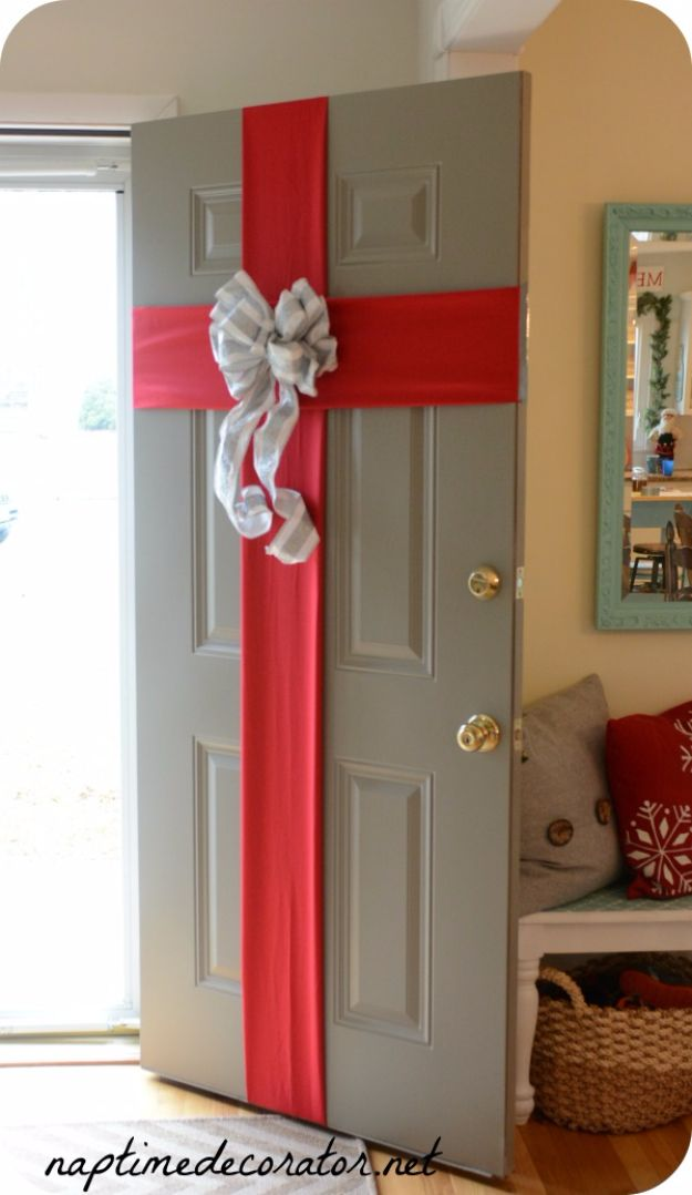 Cheap DIY Christmas Decor Ideas and Holiday Decorating On A Budget - Gift Wrapped Front Door - Easy and Quick Decorating Ideas for The Holidays - Cool Dollar Store Crafts for Xmas Decorating On A Budget - wreaths, ornaments, bows, mantel decor, front door, tree and table centerpieces - best ideas for beautiful home decor during the holidays http://diyjoy.com/cheap-diy-christmas-decor