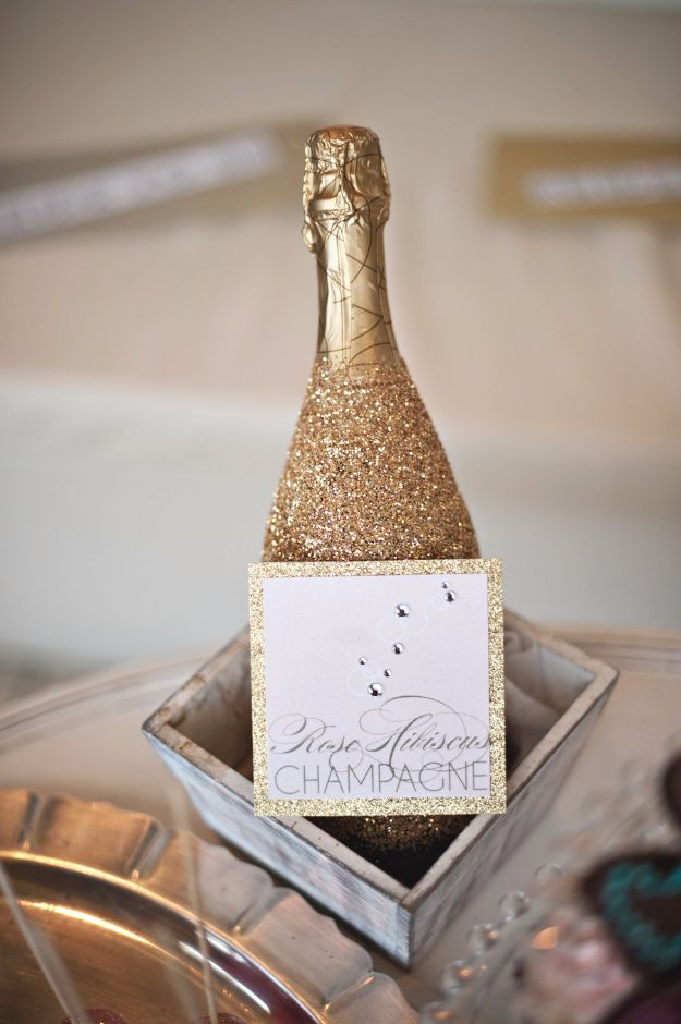 New Years Eve Decor Ideas - Glittered Wine Bottle - DIY New Year's Eve Decorations - Cheap Ideas for Banners, Balloons, Party Tables, Centerpieces and Festive Streamers and Lights - Cool Placecards, Photo Backdrops, Party Hats, Party Horns and Champagne Glasses - Cute Invitations, Games and Free Printables #diy #newyearseve #parties