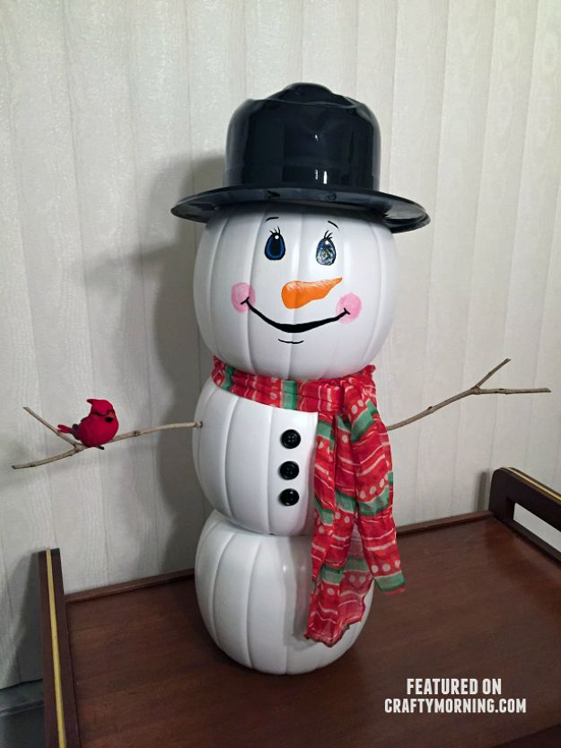 Cheap DIY Christmas Decor Ideas and Holiday Decorating On A Budget - Plastic Pumpkin Snowman - Easy and Quick Decorating Ideas for The Holidays - Cool Dollar Store Crafts for Xmas Decorating On A Budget - wreaths, ornaments, bows, mantel decor, front door, tree and table centerpieces - best ideas for beautiful home decor during the holidays http://diyjoy.com/cheap-diy-christmas-decor
