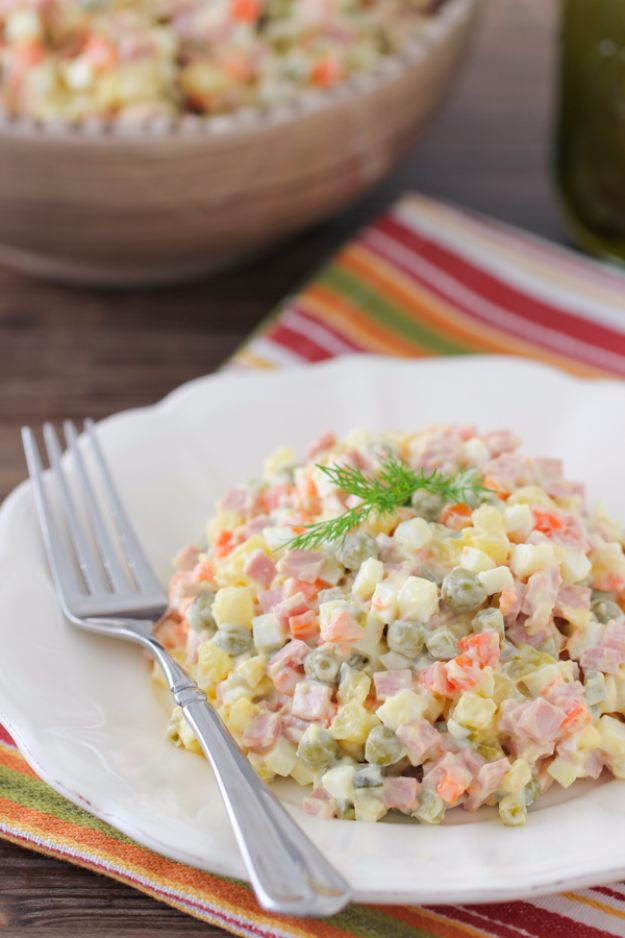 New Years Eve Party Recipes -Russian Salad Olivie - Best New Year Drinks, Cocktails, Appetizers and Party Foods for Your New Year's Eve Celebration - Quick Desserts, Snacks, Dips, Finger Foods, Cake and Champagne Toast Recipe Ideas - Fun and Easy Foods To Serve For A Crowd #newyears #recipes