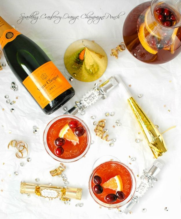 Best Drink Recipes for New Years Eve - Sparkling Cranberry-Orange Champagne Punch - Creative Cocktails, Drinks, Champagne Toasts, and Punch Mixes for A New Year's Eve Party - Ideas for Serving, Glasses, Fun Ideas for Shots and Cocktails - Easy Vodka Recipes, Non Alcoholic, Whisky Rum and Party Punches #newyearseve