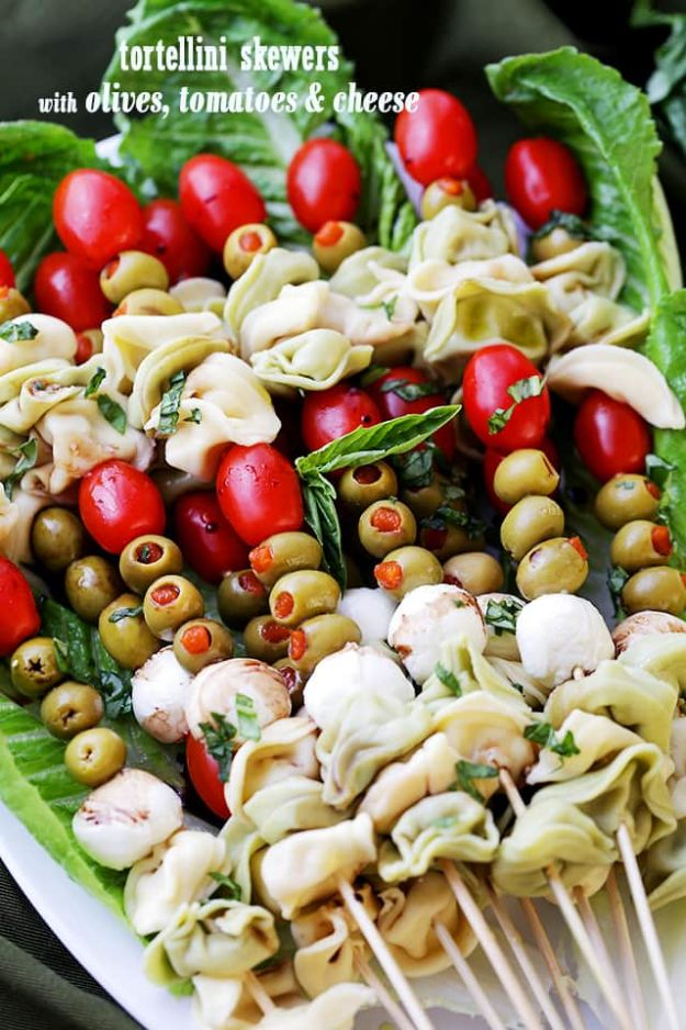 New Years Eve Party Recipes - Tortellini Skewers with Olives Tomatoes and Cheese - Best New Year Drinks, Cocktails, Appetizers and Party Foods for Your New Year's Eve Celebration - Quick Desserts, Snacks, Dips, Finger Foods, Cake and Champagne Toast Recipe Ideas - Fun and Easy Foods To Serve For A Crowd http://diyjoy.com/new-years-eve-recipes