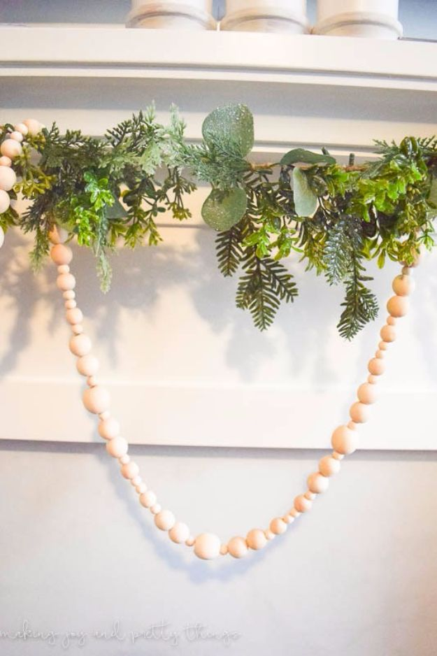 Best DIY Home Decor Crafts - Wood Bead Garland - Easy Craft Ideas To Make From Dollar Store Items - Cheap Wall Art, Easy Do It Yourself Gifts, Modern Wall Art On A Budget, Tabletop and Centerpiece Tutorials - Cool But Affordable Room and Home Decor With Step by Step Tutorials #diyhomedecor