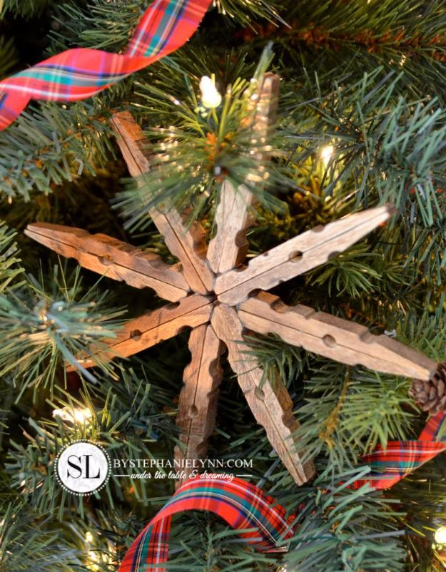 Cheap DIY Christmas Decor Ideas and Holiday Decorating On A Budget - Wooden Clothespin Snowflake Ornaments - Easy and Quick Decorating Ideas for The Holidays - Cool Dollar Store Crafts for Xmas Decorating On A Budget - wreaths, ornaments, bows, mantel decor, front door, tree and table centerpieces - best ideas for beautiful home decor during the holidays http://diyjoy.com/cheap-diy-christmas-decor