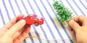 Watch The Clever Thing She Does With This Little Red Car And Christmas Tree!