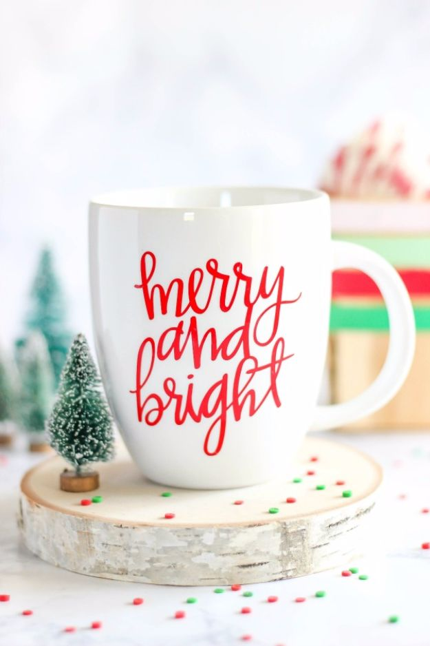 DIY Coffee Mugs - DIY Merry and Bright Vinyl Mug - Easy Coffee Mug Ideas for Homemade Gifts and Crafts - Decorate Your Coffee Cups and Tumblers With These Cool Art Ideas - Glitter, Paint, Sharpie Craft, Nail Polish Water Marble and Teen Projects http://diyjoy.com/diy-coffee-mugs