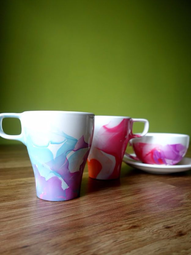 DIY Coffee Mugs - DIY Nail Polish Marbled Mugs - Easy Coffee Mug Ideas for Homemade Gifts and Crafts - Decorate Your Coffee Cups and Tumblers With These Cool Art Ideas - Glitter, Paint, Sharpie Craft, Nail Polish Water Marble and Teen Projects http://diyjoy.com/diy-coffee-mugs