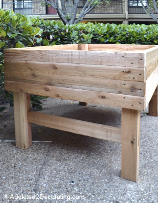 DIY Garden Beds - Elevated Garden Bed - Easy Gardening Ideas for Raised Beds and Planter Boxes - Free Plans, Tutorials and Step by Step Tutorials for Building and Landscaping Projects - Update Your Backyard and Gardens With These Cheap Do It Yourself Ideas http://diyjoy.com/diy-garden-beds