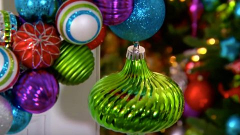 she slides wire through ball ornaments and creates this amazing