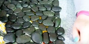 What She Does With River Rocks Is A Chic And Stylish Addition To Your Decor. Watch!