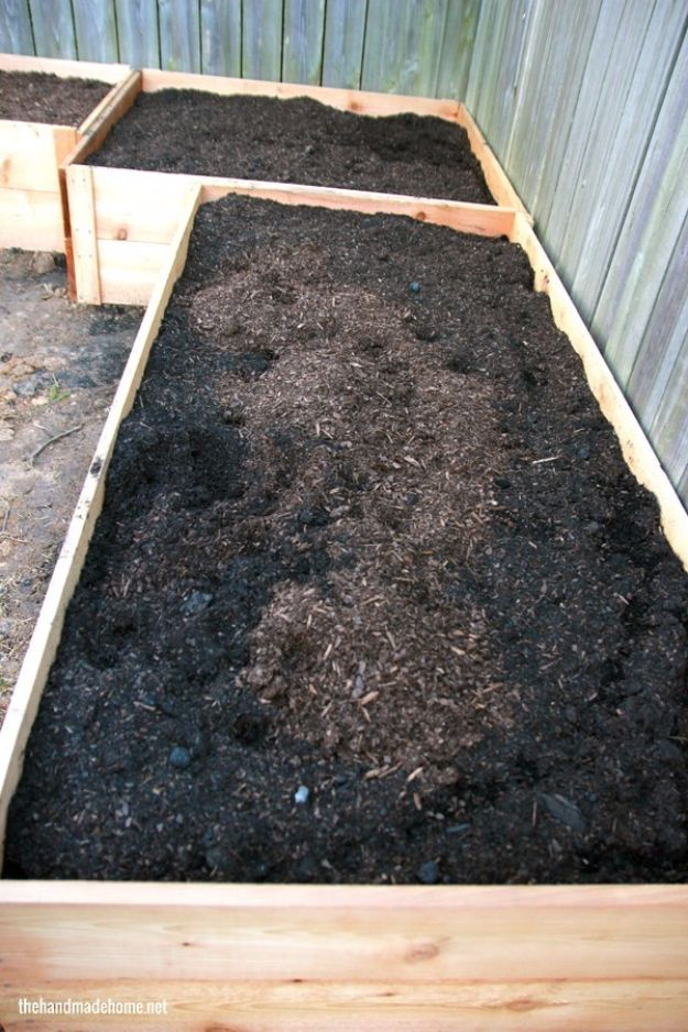 DIY Garden Beds - Simple Cedar Garden Bed - Easy Gardening Ideas for Raised Beds and Planter Boxes - Free Plans, Tutorials and Step by Step Tutorials for Building and Landscaping Projects - Update Your Backyard and Gardens With These Cheap Do It Yourself Ideas http://diyjoy.com/diy-garden-beds