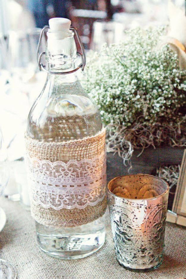DIY Burlap Ideas - Burlap And Lace Bottle - Burlap Furniture, Home Decor and Crafts - Banners and Buntings, Wall Art, Ottoman from Coffee Sacks, Wreath, Centerpieces and Table Runner - Kitchen, Bedroom, Living Room, Bathroom Ideas - Shabby Chic Craft Projects and DIY Wedding Decor http://diyjoy.com/diy-burlap-decor-ideas
