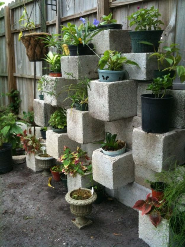 Container Gardening Ideas - Cinder Block Focal Point Vertical Planter - Easy Garden Projects for Containers and Growing Plants in Small Spaces - DIY Potting Tips and Planter Boxes for Vegetables, Herbs and Flowers - Simple Ideas for Beginners -Shade, Full Sun, Pation and Yard Landscape Idea tutorials http://diyjoy.com/container-gardening-ideas