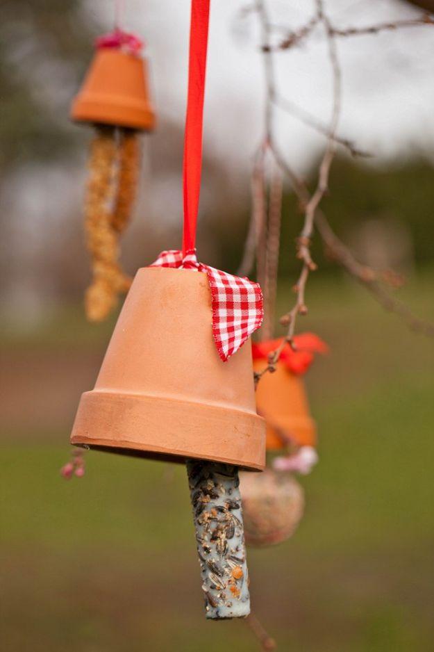 DIY Bird Feeders - Clay Pot Bird Feeder - Easy Do It Yourself Homemade Bird Feeder Ideas from Mason Jar, Wooden, Wine Bottle, Milk Jug, Plastic, Dollar Store Supplies - Squirrel Proof, Unique and Creative Tutorials That Make Cool DIY Gifts #diyideas #birds