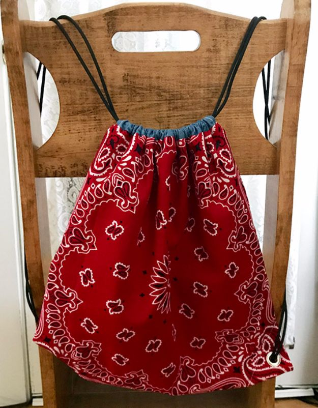 DIY Ideas With Bandanas - DIY Drawstring Bandana Backpack - Bandana Crafts and Decor Projects Made With A Bandana - No Sew Ideas, Bags, Bracelets, Hats, Halter Tops, Blankets and Quilts, Headbands, Simple Craft Project Tutorials for Kids and Teens - Home Decoration and Country Themed Crafts To Make and Sell On Etsy http://diyjoy.com/diy-ideas-bandanas
