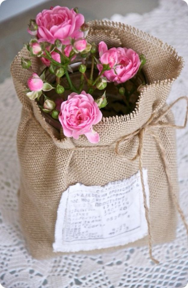 DIY Burlap Ideas - Flowers Wrapped In Burlap - Burlap Furniture, Home Decor and Crafts - Banners and Buntings, Wall Art, Ottoman from Coffee Sacks, Wreath, Centerpieces and Table Runner - Kitchen, Bedroom, Living Room, Bathroom Ideas - Shabby Chic Craft Projects and DIY Wedding Decor http://diyjoy.com/diy-burlap-decor-ideas