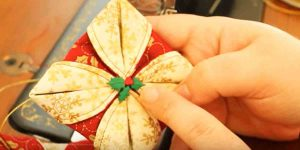 She Sews Two Circles Of Fabric Together And Folds It Into A Beautiful Holiday Item!