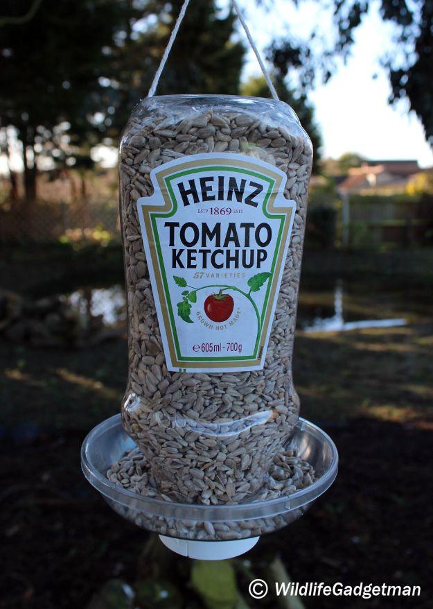 DIY Bird Feeders - Ketchup Bottle Bird Feeder - Easy Do It Yourself Homemade Bird Feeder Ideas from Mason Jar, Wooden, Wine Bottle, Milk Jug, Plastic, Dollar Store Supplies - Squirrel Proof, Unique and Creative Tutorials That Make Cool DIY Gifts #diyideas #birds