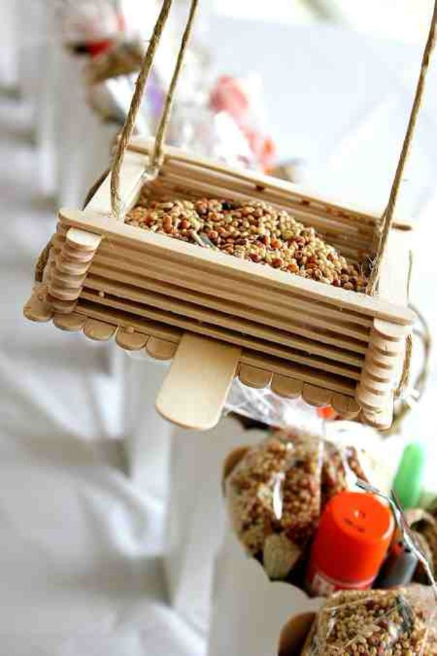 DIY Bird Feeders - Popsicle Stick Bird Feeders - Easy Do It Yourself Homemade Bird Feeder Ideas from Mason Jar, Wooden, Wine Bottle, Milk Jug, Plastic, Dollar Store Supplies - Squirrel Proof, Unique and Creative Tutorials That Make Cool DIY Gifts #diyideas #birds