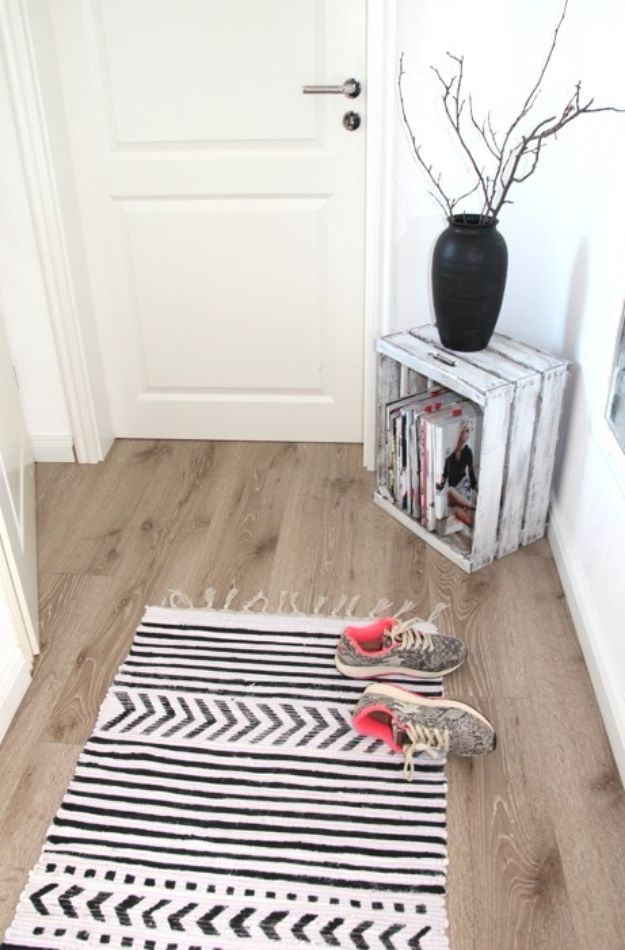 DIY Rugs - Black Fabric Painted Rug - Ideas for An Easy Handmade Rug for Living Room, Bedroom, Kitchen Mat and Cheap Area Rugs You Can Make - Stencil Art Tutorial, Painting Tips, Fabric, Yarn, Old Denim Jeans, Rope, Tshirt, Pom Pom, Fur, Crochet, Woven and Outdoor Projects - Large and Small Carpet http://diyjoy.com/diy-rug-tutorials