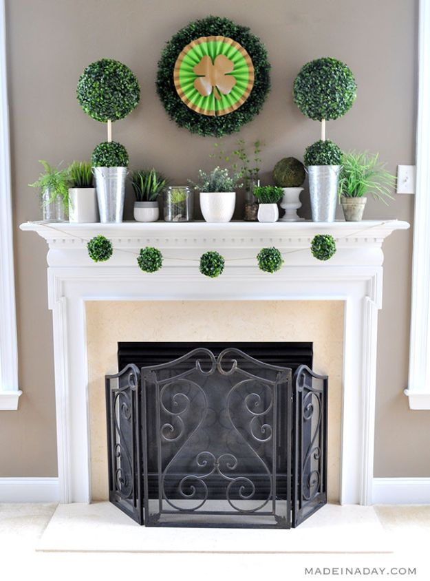 St Patricks Day Decor Ideas - Boxwood Topiaries Garland St Patricks Day Mantle - DIY St. Patrick's Day Party Decorations and Home Decor Crafts - Projects for Walls, Hanging Banners, Wreaths, Tabletop Centerpieces and Party Favors - Green Shamrocks, Leprechauns and Cute and Easy Do It Yourself Decor For Parties - Cheap Dollar Store Ideas for Those On A Budget http://diyjoy.com/diy-st-patricks-day-decor