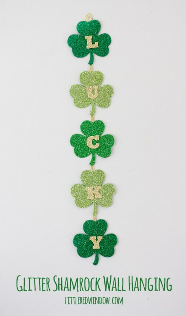 St Patricks Day Decor Ideas - Glittery Lucky Shamrock Wall Hanging - DIY St. Patrick's Day Party Decorations and Home Decor Crafts - Projects for Walls, Hanging Banners, Wreaths, Tabletop Centerpieces and Party Favors - Green Shamrocks, Leprechauns and Cute and Easy Do It Yourself Decor For Parties - Cheap Dollar Store Ideas for Those On A Budget http://diyjoy.com/diy-st-patricks-day-decor