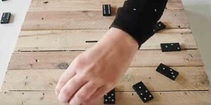 He Strategically Places Dominos On A Pallet Wood Square And Creates A Clever Item!