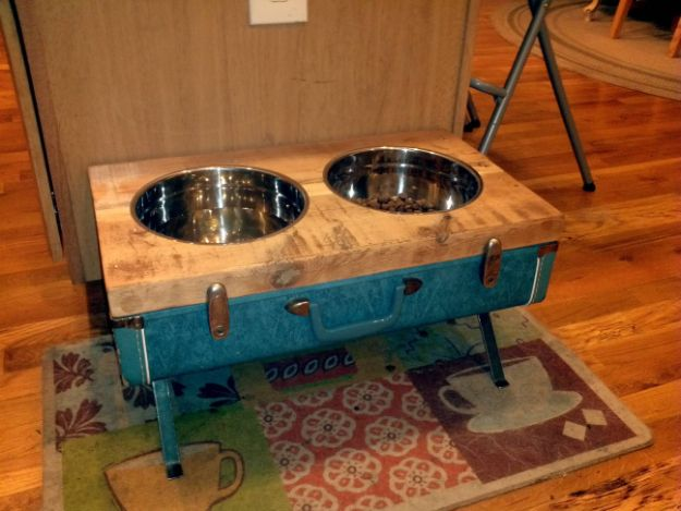 DIY Pet Bowls And Feeding Stations - Raised Dog Bowls From Vintage Suitcase - Easy Ideas for Serving Dog and Cat Food, Ways to Raise and Store Bowls - Organize Your Dog Food and Water Bowl With These Cute and Creative Ideas for Dogs and Cats- Monogram, Painted, Personalized and Rustic Crafts and Projects http://diyjoy.com/diy-pet-bowls-feeding-station