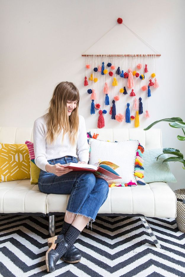 DIY Wall Hangings - Ridiculously Adorable Pom-Pom Tassel Wall Hanging - Easy Yarn Projects , Macrame Ideas , Fabric Tapestry and Paper Arts and Crafts , Planter and Wood Board Ideas for Bedroom and Living Room Decor - Cute Mobile and Wall Hanging for Nursery and Kids Rooms http://diyjoy.com/diy-wall-hangings