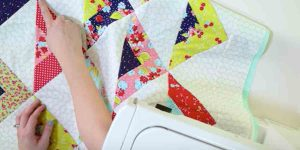 You'll Fall In Love With This Striking Scrappy Triangle Throw Quilt. Watch!