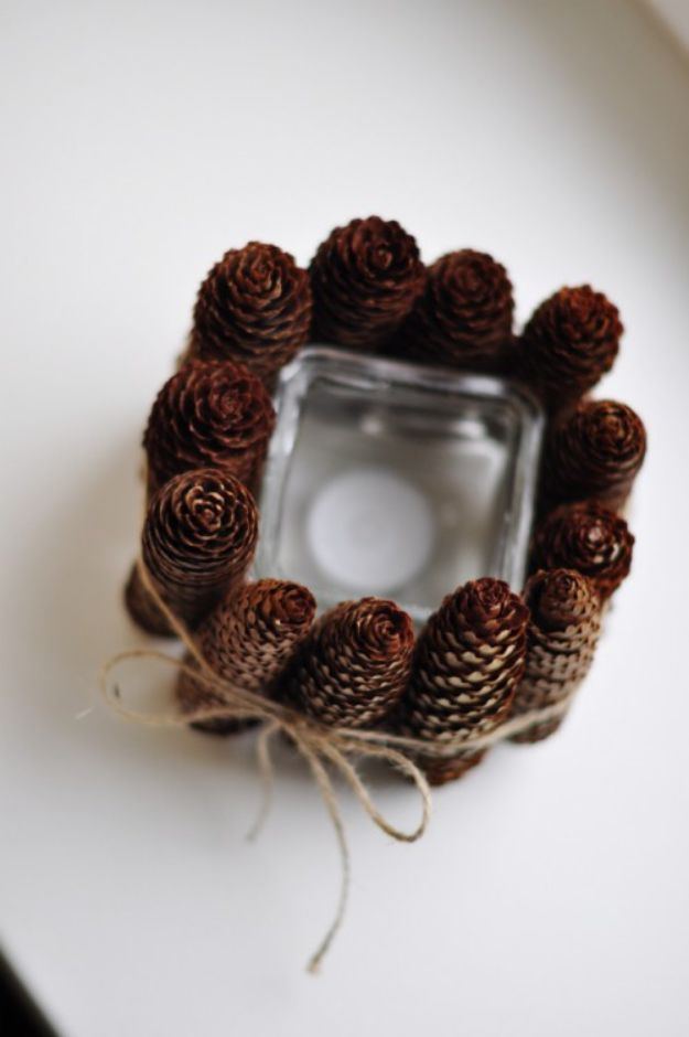 DIY Candle Holders - Simple DIY Pine Cone Candle Holder - Easy Ideas for Home Decor With Candles, Tall Candlesticks and Votives - Fun Wooden, Rustic, Glass, Mason Jar, Boho and Projects With Items From Dollar Stores - Christmas, Holiday and Wedding Centerpieces - Cool Crafts and Homemade Cheap Gifts http://diyjoy.com/diy-candle-holders