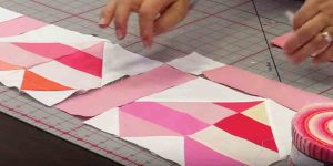 "She Cuts Shapes To Make Hearts And Sews This Beautiful ""Tender Heart"" Quilt. Learn How!"