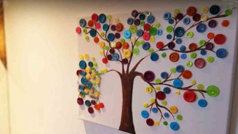 After Painting A Tree On Canvas She Glues Buttons On The Branches