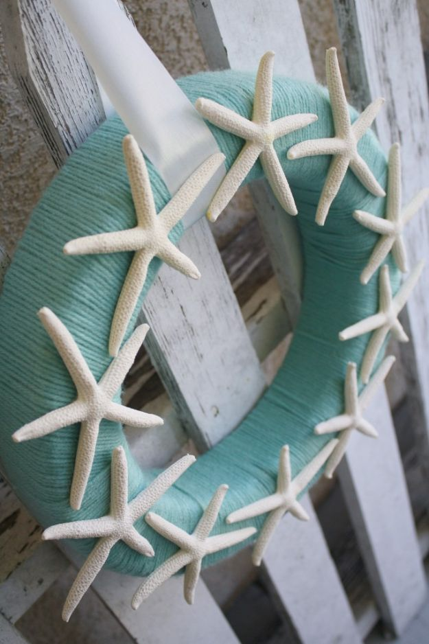 DIY Beach House Decor - Starfish Yarn Wreath - Cool DIY Decor Ideas While On A Budget - Cool Ideas for Decorating Your Beach Home With Shells, Sand and Summer Wall Art - Crafts and Do It Yourself Projects With A Breezy, Blue, Summery Feel - White Decor and Shiplap, Birchwood Boats, Beachy Sea Glass Art Projects for Living Room, Bedroom and Kitchen