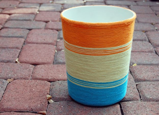 DIY Trash Cans - Yarn Wrapped Trash Can DIY - Easy Do It Yourself Projects to Make Cute, Decorative Trash Cans for Bathroom, Kitchen and Bedroom - Trash Can Makeover, Hidden Kitchen Storage With Pull Out Cabinet - Lids, Liners and Painted Decor Ideas for Updating the Bin #diykitchen #diybath #trashcans #diy #diyideas #diyjoy http://diyjoy.com/diy-trash-cans