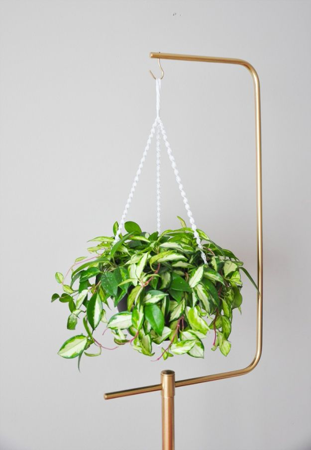 DIY Plant Hangers - DIY Macramé Plant Hanger And Gold Plant Stand - Cute and Easy Home Decor Ideas for Plants - How To Make Planters, Hanging Pot Holders, Wire, Rope and Baskets - Quick DIY Gifts Ideas, Macrame Plant Hanger http://diyjoy.com/diy-plant-hangers-stands
