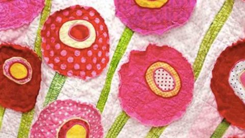 She shows us a super easy way to add raw edge applique patches to