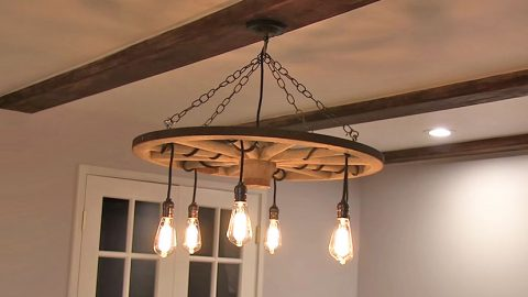 Upcycle A Wagon Wheel Into The Coolest Chandelier | DIY Joy Projects and Crafts Ideas