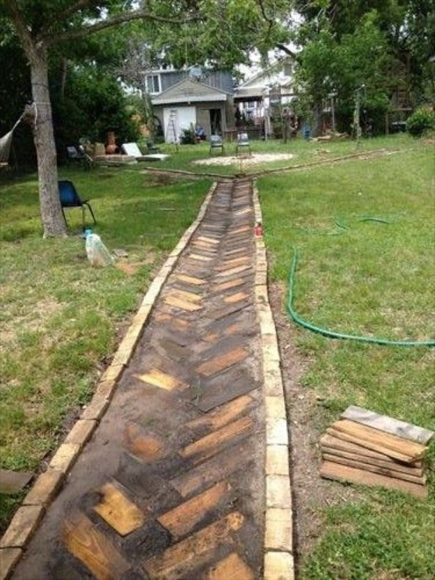 DIY Walkways - Artistic yet Unique Pallet Wood Walkway - Do It Yourself Walkway Ideas for Paths to The Front Door and Backyard - Cheap and Easy Pavers and Concrete Path and Stepping Stones - Wood and Edging, Lights, Backyard and Patio Walks With Gravel, Sand, Dirt and Brick http://diyjoy.com/diy-walkways